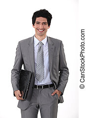 portrait of handsome young businessman all smiles with laptop