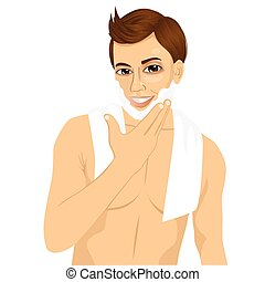 young man applying shaving cream foam