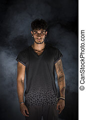 Portrait of handsome young man in dark t-shirt