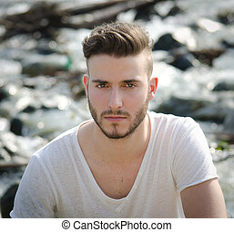 Portrait of handsome young man in white t-shirt