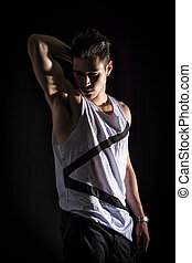Portrait of handsome young man in white tank-top