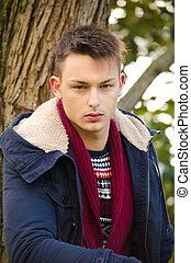 Portrait of handsome young man in winter clothes