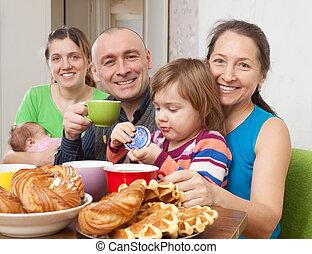 Portrait of happ family drinks tea