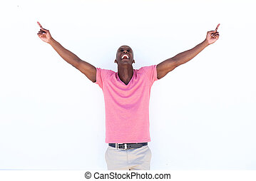 happy african american man laughing with arms outstretched