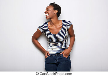 happy african american woman laughing against gray background