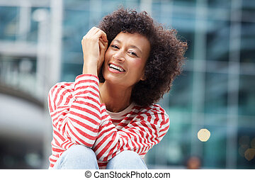 happy african american woman laughing outdoors