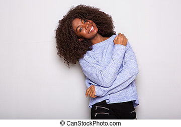 happy african american woman looking at camera on white background