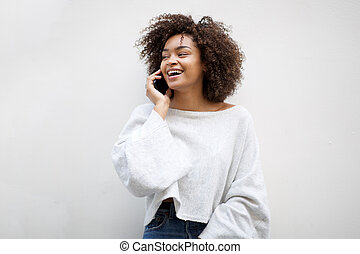 happy african american woman talking with mobile phone by white background