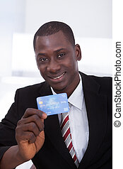 Businessman Holding Credit Card - Portrait Of Happy African...