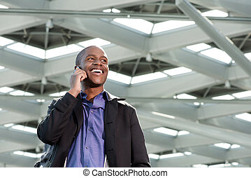 happy african businessman talking on mobile phone