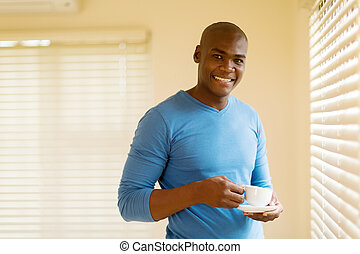 african man having cup of coffee