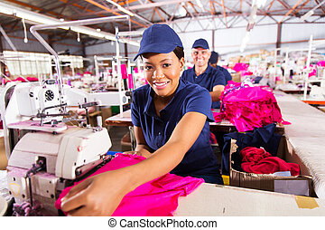african worker in textile factory - portrait of happy ...