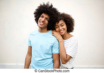 happy afro man and smiling african american woman against white background