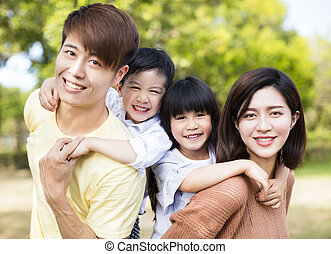 Portrait Of Happy asian Family Inthe park