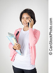 Happy asian teenage student calling cell phone