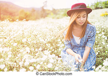 Portrait of Happy Asian woman smiling in The Chrysanthemum garden
