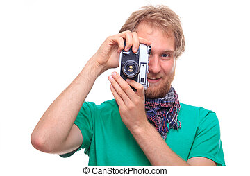 Portrait of happy bearded man with classic camera