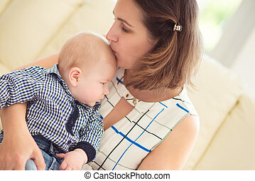 Portrait of happy beautiful mother and baby
