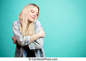 Portrait of happy blonde woman in jeans jacket