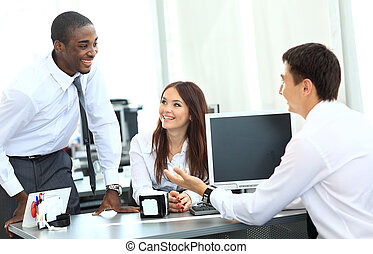 Portrait of happy business team having meeting in office