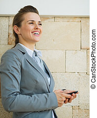 Portrait of happy business woman looking into distance