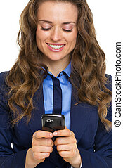 Portrait of happy business woman writing sms