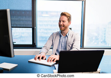 Portrait of happy business working in office