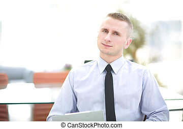 Portrait of happy businessman in office