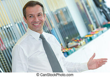 portrait of happy businessman standing in office