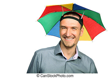 Portrait of happy businessman with rainbow hat umbrella on ...