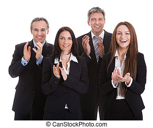 Portrait Of Happy Businesspeople Clapping Over White Background