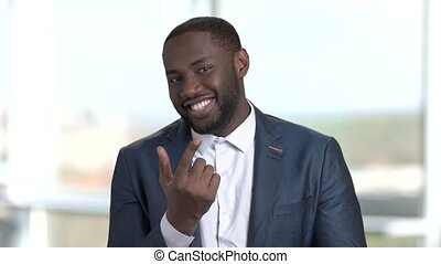 Portrait of happy cheerful african black man calling you.