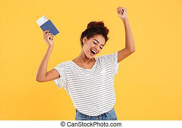 Portrait of happy cheerful holding international passport...