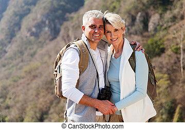 couple hiking in autumn mountain
