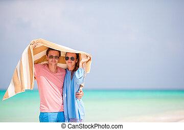 Portrait of happy couple in honeymoon on the beach