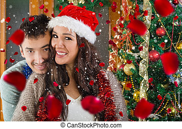 Portrait of happy couple in love at Christmas time