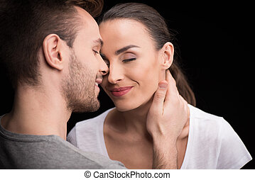 portrait of happy couple in love with closed eyes