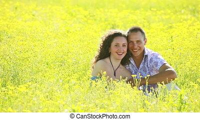 Portrait of happy couple in meadow