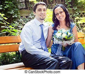 Portrait of happy couple in park