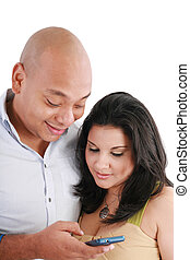 portrait of happy couple with cellphone on white. Focus on the woman.
