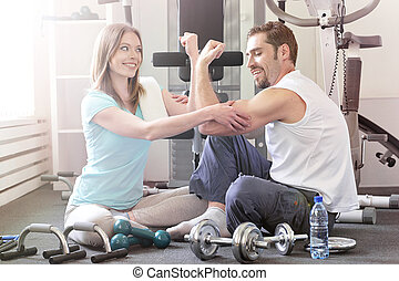 couple working out together in a gym