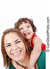 Portrait of happy daughter enjoying a piggyback ride on mothers back, isolated over white. Focus on the child
