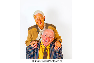 portrait of happy elderly senior couple