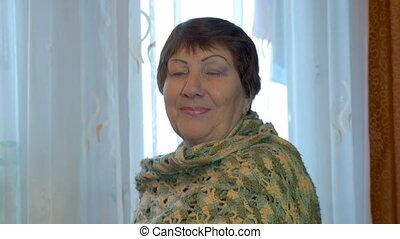 Portrait of happy elderly woman.