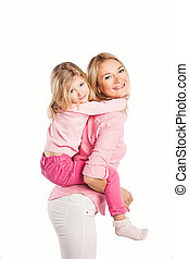 Portrait of happy embracing mother and daughter