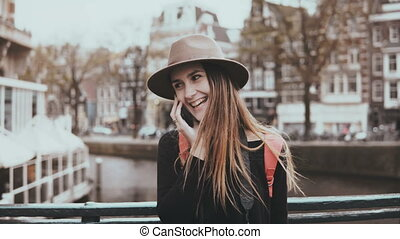 Portrait of happy European girl talk on the phone. Zoom in. Pretty woman chatting with a friend smiling cheerfully. 4K.