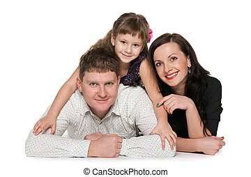 Portrait of happy family against the white