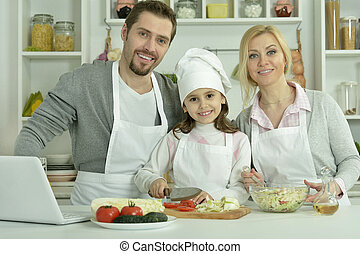 Portrait of happy family cooking in kitchen