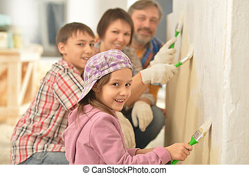 happy family doing repair at home - portrait of happy family...