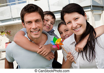 Portrait of happy family enjoying outdoors - Portrait of...